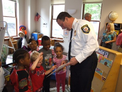 Albany Police Chief Steve Krokoff reads to children at Joseph L. Bruno Family Resource Center in Troy